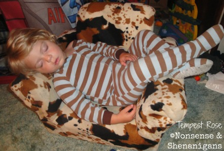 son sleeping in chair