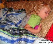toddler sleeping on couch