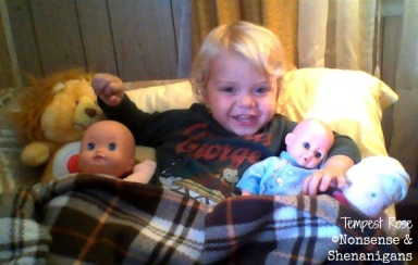 "Holden with several of his ""girly"" baby dolls."