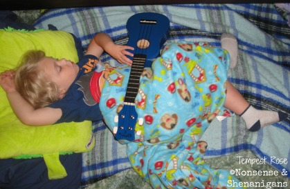 toddler sleeping with guitar