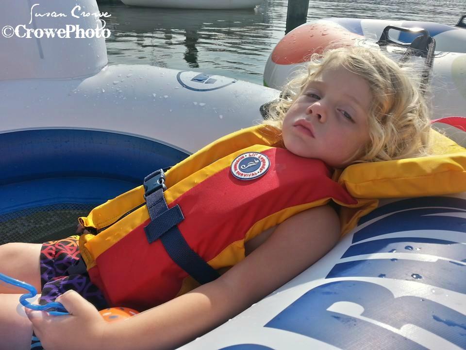 Toddler sleeping while tubing