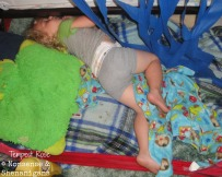 Toddler sleeping under bed