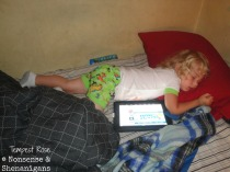 Toddler sleeping with iPad
