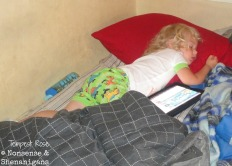 Toddler sleeping with iPad in parents' bed