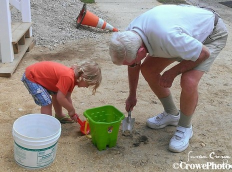 great grandfather digging with great grandson