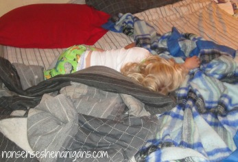 toddler sleeping in parents' bed