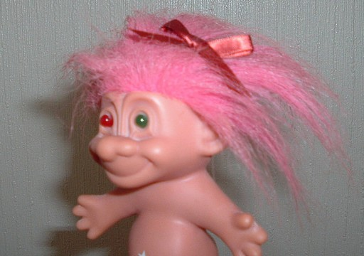 creepy troll hugging two different color eyes